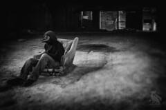 Sit with Merula (CJ Schmit) Tags: wwwcjschmitcom 5dmarkiii canon canon5dmarkiii cjschmit cjschmitphotography canonef1740mmf40lusm photographermilwaukee milwaukeephotographer photographerwisconsin dragonspitstudios merula blackbird mask man creepy gary indiana church stalker dark jeans dof creeper plaguedoctormask plaguemask steampunk projectmerula chair theater bricks monochrome blackandwhite bw nikanalogefex2