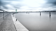 Mouth of river Trave (Travemnde) (langtimoalex) Tags: mouth river trave travemnde lbeck bay germany see ostsee baltic sea long exposure lighthouse sony alpha 7 mk ii zeiss loxia 21mm sky clouds