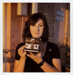 Synthia & Her SX-70 (tobysx70) Tags: the impossible project tip polaroid slr680 frankenroid sx70 door rollers film for 600 type cameras instant impossaroid synthia and her norman roscoe evers hardware building west hickory street denton texas tx portrait camera golden hour apple watch polacon2016 polaconone 100116 toby hancock photography