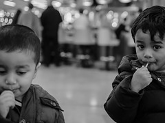 Lollypop Buddies (Mayur Shivz - Out and about casual photography) Tags: bokeh shallow bw baby innocent lollypop candy cute little olympus omd em5 panasonic leica 25mm micro four third mft mayur shiv photography friends buddies blackwhite
