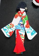 All-purpose handmade card 14_closeup of doll (tengds) Tags: red white black flower card kimono obi papercraft japanesepaper ningyo handmadecard bingata handmadeflower japanesepaperdoll nailsticker washidoll origamidoll tengds allpurposecard bingatapaper okinawapaper