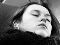 Sleeping Beauty (d_t_vos) Tags: sleeping blackandwhite bw woman white black travelling eye girl face contrast train mouth nose evening chair ns bn pale compartment traveller tired teenager earphone shawl eyesclosed railways youngwoman sleepingbeauty coupé eyesshut facesofportraits dickvos dtvos