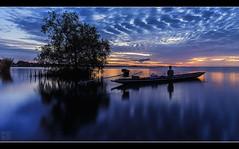 Coxswain & Craft (musicexpression) Tags: blue water silhouette thailand boat still hour th boatman sampan tambonlampam changwatphatthalung