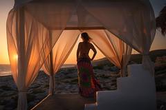 Evening Chill (Arek Adeoye) Tags: travel sunset sea woman sun girl beautiful relax evening greece frame pictureoftheday goldenhour zakynthos chillout rockbeach pickoftheday portoroxa