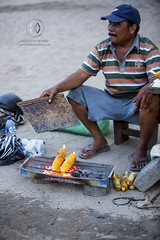 A local vendor sells corn on the beach. (wrightontheroad) Tags: local beachbarbecue corn localbarbecue localfood sanur bali indonesia