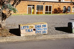 Let's Talk English! (nicotinegum) Tags: road morning winter urban sun cold building brick english sunshine 35mm canon graffiti kodak decay australia ishootfilm dirty 400 block gravel wollongong gday ultramax t50 filmisnotdead