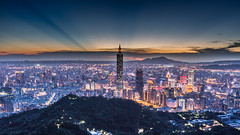 Rays Behind Taipei 101  (Sharleen Chao) Tags: city longexposure sunset urban color building horizontal skyline night clouds skyscraper canon landscape cityscape outdoor taiwan nopeople 101  taipei nightscene bluehour taipei101  dramaticsky  tone  partlycloudy highangle 101 capitalcity  canoneos5dmarkiii 2016typhoon1