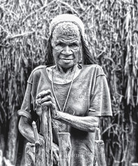 Indonesia- The Baliem Valley: Dani tribe grandma (Exper!ence it) Tags: indonesia papua baliem valley tribes remote nature dani jungle jayapura blackandwhite bw guiding hiking walking trekking