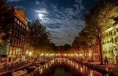 Amsterdam Lights (rolo_061) Tags: city nightlife dam amsterdam holland canal canals moonlight outdoor citylights quite lights water reflection buildings damsquare bicycles rohite nepali nightphotography contrast dark netherlands dutch river skyline road architecture night