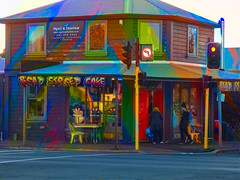 The Beat Street Cafe (Steve Taylor (Photography)) Tags: beatstreet cafe trafficlights art digital architecture building street road colourful rainbow weird mad odd strange wood wooden newzealand nz southisland canterbury christchurch city man woman lady lad sunshine sunny vivid