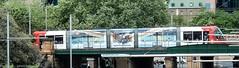 Sydney Light Rail - LRV 2112 arrives at Central, crossing the 1906 heritage bridge (john cowper) Tags: sydneylightrail lrv2112 centralrailwaystation heritage bridge 1906 eddyavenue urbos3 transportfornsw tram sydney newsouthwales