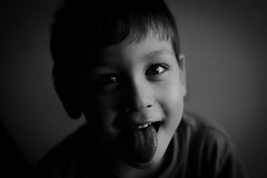 Silly (imad daoud) Tags: boy portrait bw white black silly face tongue photography kid eyes child shot head sony photograph a7