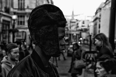 IMG_9746-Edit (roger_thelwell) Tags: life street city uk winter portrait england people urban bw white black streets cold london lamp monochrome westminster beauty hat rain leather mobile umbrella hair bag walking real photography mono chat shiny phone traffic post natural photos britain circus cigarette candid cab taxi great over sac hats cell photographic smoking lamppost photographs oxford conversation shiney talking shoulder handbag stud speak speaking studs commuters scak