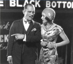 Lon Chaney and-Marceline Day-in-The Big City 1928 (Chatwick Harpax) Tags: greatbritain sexy movie play princess theatre gang screen sensual mob thief copper rum posh charming johnnydepp flappers jewels mobster trap bait mafia valentinesday reddress steal lure devious alluring vaudeville prohibition captainmorgan tomfoolery burglar tempting decoy dazzling glamorous silentfilm tricked damsel charityball roaringtwenties racketeer academyaward bunco catburglar glittering tocatchathief glitzy deceitful dastardly lonchaney skullduggery villainous scintillating beguiled conned marcelineday jewelthief ronricorum satingown catthief sparklingjewels silentscreenactress britishmystery brutishmystery britishdetective lostfilmsilver