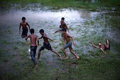 FOOTBALL in the FIELD (N A Y E E M) Tags: boys football rain monsoon field paddy water street chittagongcoxsbazaarhighway chittagong bangladesh