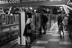 Another 2 minutes wait (sydbad) Tags: bukitbintang monorail station streetphotography another 2minutes wait ilce6000 sel35f28z blackandwhite