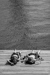 No worries! (Mustafa Selcuk) Tags: barcelona street travel people blackandwhite bw monochrome relax spain streetphotography monochromatic sunbath sb bnw barselona siyahbeyaz seyahat ispanya