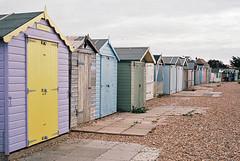 Beach Hut Row (Song-to-the-Siren) Tags: konicahexaraf ektar100 ektar filmcamera film 35mm classiccamera ferring beach coast beachhuts