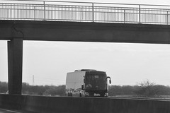Skills On The Motorway. (ManOfYorkshire) Tags: skils coach bus motorway ferrybridge a1 a1m bw blackwhite led lights shadow overbridge railings bridge concrete