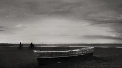 (toni jara) Tags: cielo monocromtico clouds blancoynegro atardecer blur grain bikes malvarrosa boat moody drama