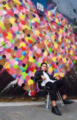 Nick (Nailah Fisher) Tags: manhattan lower east side new york color heart red blue green yello yellow pink street art design paint spray men man boy mens menswear fashion chair sitting circles circle hek tad portrait