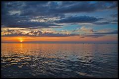 Delaware Bay Sunset Looking Toward the Ice Breaker, Known to Locals as the Haystacks (stevebfotos) Tags: capehenlopen sun icebreakers sunset topaz water hdr boat harborofrefuge haystacks delawarebay capemaylewesferry reviewtodelete