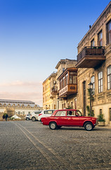 The beauty of the old city BAKU (Suwaidyah) Tags:        hotred classiccar classiccars redcar red blue details nikond4s nikon architecture archinect old travel azerbaijan oldcitybaku baku
