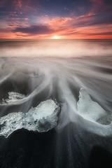 Gems (cohenalac) Tags: ocean longexposure light sunset sun black ice beach nature water clouds sunrise coast landscapes iceland sand waves glacier rays landscaoe