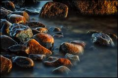 Wet Rocks (Jonas Thomn) Tags: sunset sea water suomi finland rocks stones vatten hav pietarsaari solnedgng stenar nd400 jakobstad fboda