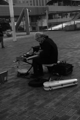 one man band (martynwhit) Tags: park portrait people blackandwhite musician music man streets monochrome japan canon photography japanese tokyo photo keyboard streetphotography photograph violin odaiba tamron kazoo