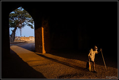 Keep Walking (ujjal dey) Tags: morning travel light golden alone fort walk oldman johnniewalker bidar keepwalking