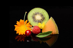 Obst (Theo Crazzolara) Tags: juicy saftig black background color schwarz hintergrund schwarzer fruits frchte obst healthy gesund lifestyle diet plants pflanzen orange green grn gelb yellow melone melon zuckermelone zucker sweet ss muskmelon sugar epic episch studio foodporn msli ripe reif fresh frisch red rote himbeere raspberry raspberries farbe kiwi kiwifruit cherry kirsche minze pfefferminze mint flower blume blossom blte ringelblume common marigold