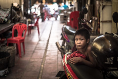 A child on the street (Dio Wong) Tags: streetphotography photography travelphotography  cambodia calligraphy travel diowong canon travelphoto diophoto    kid  smile