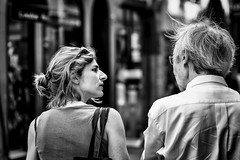Question... ? (Periades) Tags: bw blackandwhite blackwhite couple cheveux femme girl human homme hair nb noiretblanc candid photoderue rue streetphotography street streethuman woman