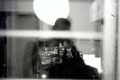 11. Visiones (Rubn T.F.) Tags: bnw black white selfie myself selfportrait portrait reflected glass window urban street rain winter