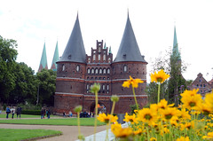 Holstentor (Wolfgang Binder) Tags: luebeck city holstentor sight flowers grass nikon d7000 zeiss distagon distgaont2825 building architecture history