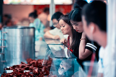 Shopping For Duck Parts In Chinatown (Jon Siegel) Tags: nikon nikkor d810 85mm 14 nikon85mmf14 woman women girl boy afternoon shopping ducks duck meat organs chinatown chinese singapore singaporean street candid city