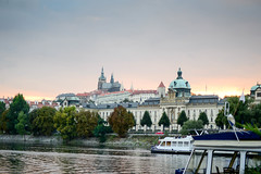 Serene sunset cruise (mraogr) Tags: prague czechrepublic czech building buildings architecture structure sunset cruise river rivervltava vltava moldova boat riverside views view praguecastle stvituscathedral skyline waterfront riverfront light
