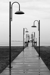 Pontile (`Olivier Jules`) Tags: vasto abruzzo chieti pontile spiaggia beach blackandwhite rain sand sea mare see lamp lampione passerella cemento armato disarmato obiettore di coscienza