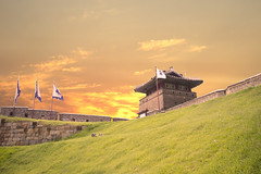 Twilight at Fort Suwon(수원화성에서의 황혼) (Synghan) Tags: world travel sunset people sun colour macro building heritage tourism beautiful horizontal architecture canon lens landscape photography eos rebel evening landscapes dc twilight travels focus scenery kiss afternoon tour image fort no south traditional sightseeing scenic sigma sunsets korea images tourist structure unesco korean destination 1770 fortress built scenics attraction freshness attractions selective suwon 수원 t3i x5 destinations joseon twilights 세계 fragility 284 화성 600d 1770mm 조선 f284 세계유산 수원화성 suweon 세계문화유산 josun