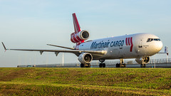 "Martinair MD-11 over taxiway Q • <a style=""font-size:0.8em;"" href=""http://www.flickr.com/photos/125767964@N08/15861190680/"" target=""_blank"">View on Flickr</a>"