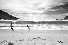 In Sungai Pinang, Sumatra (Marion Staderoli) Tags: travel sea fish men beach contrast sumatra indonesia photography blackwhite fishermen action report wave wideangle