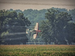 The Heat is On (clarkcg photography) Tags: trees summer hot field plane fly low spray wires turns humid cropduster heatwaves