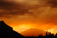 Stormy Sunset (ryan.kole32) Tags: canmore canmorealberta alberta canada canadianrockies rockies rockymountains landscape nature beauty beautyinnature sunset mountrundle cascademountain sky trees forest sony sonya77 silhouette wow