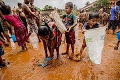 Chikal Kalo ( mud festival) (Vinita Barretto) Tags: street india festival play mud action ngc goa culture games devotion ritual tradition