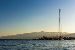 sicilianit (KeYmA78) Tags: sicily messina feluca stretto sea seascape beach ship rocks sky mediterraneo mediterranean sunset sun light