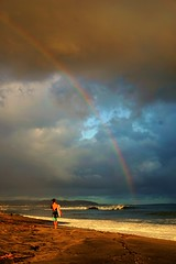 Someday, over the rainbow... (Hal Skygene) Tags: rainbow people chid child boy rain sky sea seashore shore beach sun light wave marine public outdoor stranger water weather surf surfer sunset afternoon