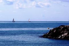In couple (Fnikos) Tags: sky skyline cloud light sea seascape shore rock boat sailboat vehicle serene outdoor
