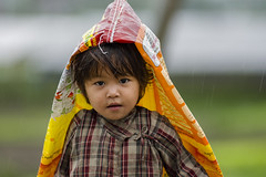child & rain (chandrackd) Tags: childrenportrait people children nepal bhaktapur photosofnepal travelnepal travelphotography photography nikon happycountry happycountrynepal