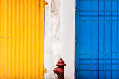 """Conjecture de l'envie et de la fiert (Conjecture of envy and pride) (""""The Wanderer's Eye Photography"""") Tags: the wanderers eye photography architecture abstract artistic background building color colorful design exterior door gate yellow red blue white grunge house line lines outside retro side street style sunlight texture timber vintage wall town firehydrant hydrant 2016 bangalore canoneos450d canoneosdslr canoneosrebelxsi digitalphotography india pondicherry puduchery rubenalexander susanalexander"""